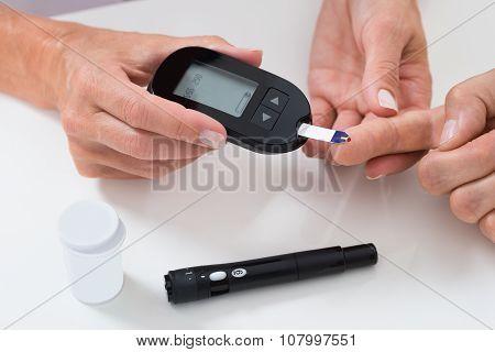Doctor Measuring Sugar Reading Of Patient