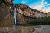 Постер, плакат: Girl Taking Picture Of The Calf Creek Falls Calf Creek Canyon Grand Staircase escalante National M