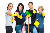 stock photo of cleaning service  - Successful cleaning people teamwork giving thumbs up and holding products for clean house - JPG