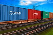 image of railroad yard  - freight train with cargo containers with motion blur effect - JPG