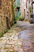 stock photo of porphyry  - old narrow alley in tuscan village - antique italian lane - tuscany italy