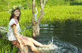 foto of undine  - girl in russian traditional clothes playing into water - JPG