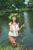 pic of undine  - girl in russian traditional clothes playing into water - JPG