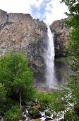 stock photo of swales  - Waterfall in mountains with sky and clouds - JPG