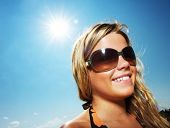 image of sunburn  - Picture of a very happy young girl outdoors - JPG