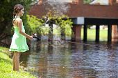 Pretty Young Girl Child Fishing On A River