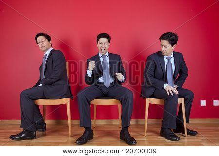 One successful businessman between two jealous businessman