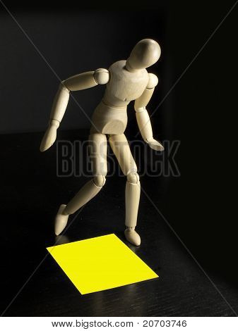 Humanoid With A Yellow Sign On The Floor By His Feet