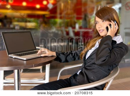 Smiles Of Young Asian Businesswoman On The Phone Working Outside.