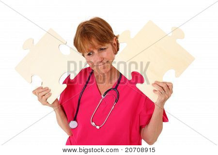 Nurse With Puzzled Look With Puzzle Pieces