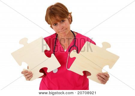 Nurse Holding Two Puzzle Pieces