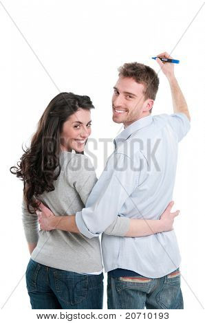 Smiling young couple writing with marker your own text isolated on white background