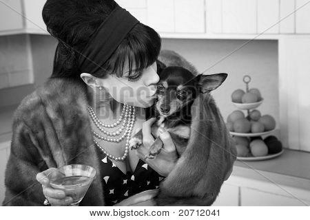 Woman Kisses A Dog