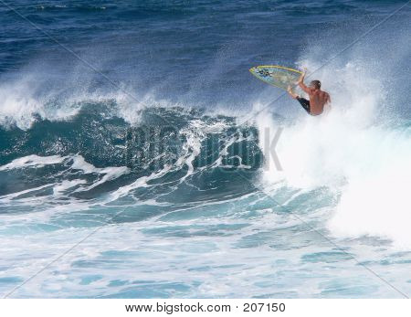 Surfer Wipes Out In Heavy Swells