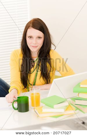 Young Student Girl With Laptop At Home