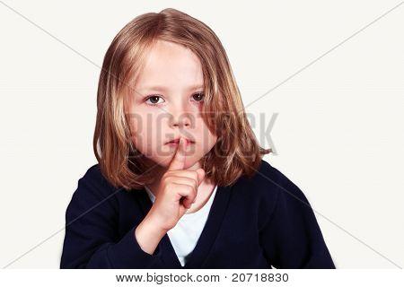 Child finger on lips