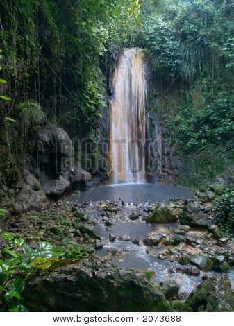 Waterfall In The Tropical Forest