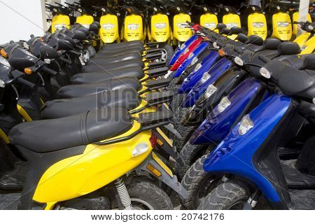 bikes motorbikes motorcycles rows in a renting shop