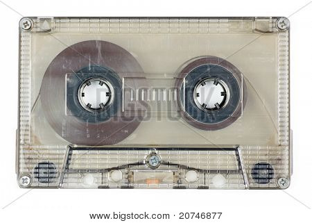 Used vintage transparent Compact Cassette on white background