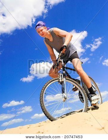 Young men  riding a bike