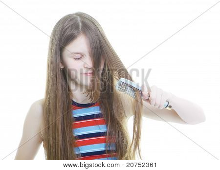 Teen Girl Combing Her Long Hair