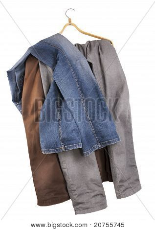 Old Shabby  Jeans Hang On A Hanger