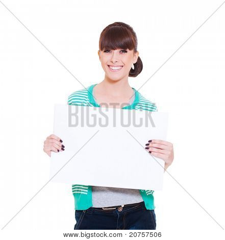 portrait of attractive smiley woman holding empty blank against white background