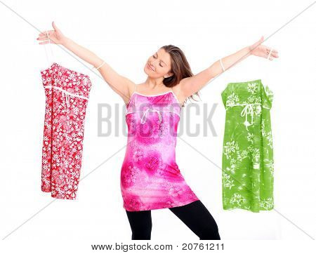 A portrait of a happy woman trying to decide between three dresses over white background