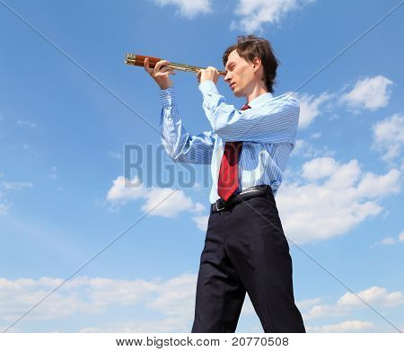 young business man  looks through a telescope