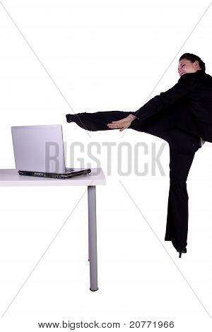 Beautiful Upset Businesswoman Kicking Laptop