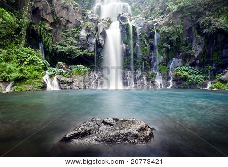 Slow shutter for moving water at Trois Bassin waterfall on Reunion Island.