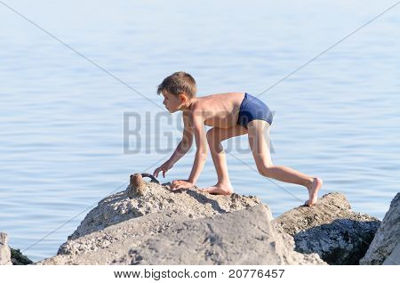 Sea, The Boy Playing And Running Around The Breakwater