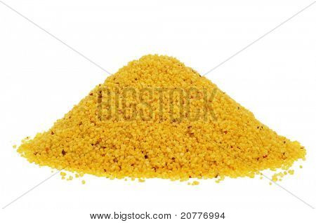 a pile of uncooked spiced couscous on a white background