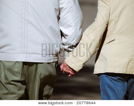Senior Couple Holding Hands During Walk