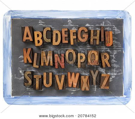 Letterpress Alphabet On Blackboard