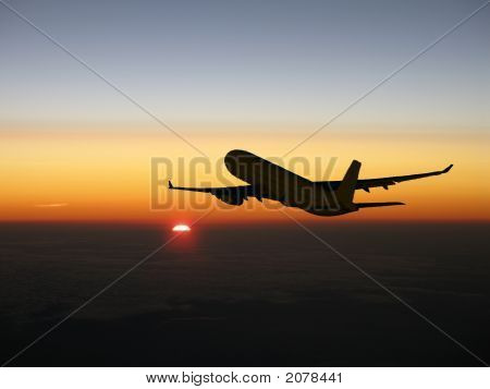 Airliner Climbing At Sunset