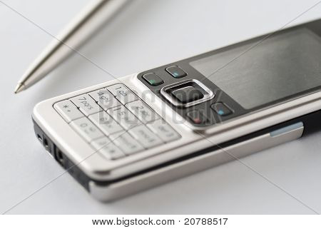 Cell phone with pen
