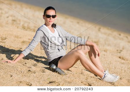 Summer Sport Fit Woman Sitting On Beach