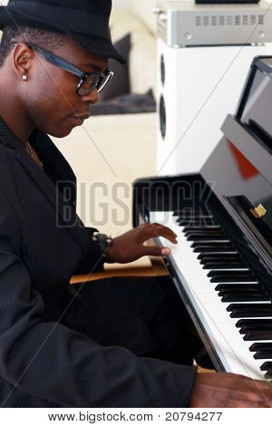 Black Musician Plays The Piano