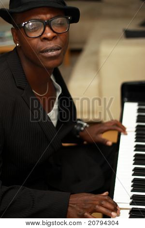 Black Musician Plays The Piano And Sings