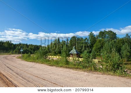 Russia. Small church at a dirt road roadside