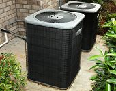 stock photo of hvac  - Residential Central Air Conditioning Units On Cement Slab - JPG