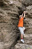 picture of climbing wall  - little boy in orange t - JPG