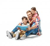Young man and his little children reading book on white background poster