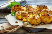Baked Potatoes In Skin With Spices, Olive Oil And Garlic. poster