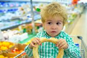 Funny Emotional Buyer In Food Store Supermarket, Boy Eats In Shopping Basket, Delicious Purchases. T poster