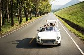 Couple Driving a Car Traveling on Road Trip Together poster