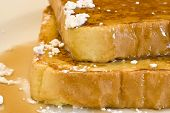 stock photo of french toast  - french toast on a white plate with powdered sugar and maple syrup - JPG