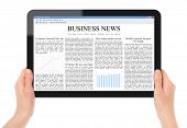 foto of sensory perception  - Female hands holding touch screen tablet with business news on screen - JPG