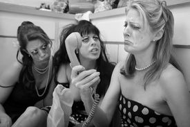 picture of pep talk  - Pouting woman on phone with friends in kitchen - JPG